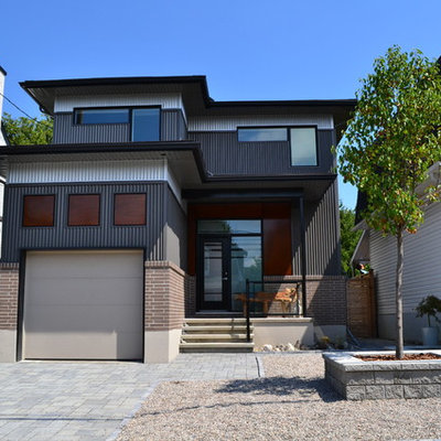 Mid-sized trendy gray two-story mixed siding exterior home photo in Ottawa with a hip roof