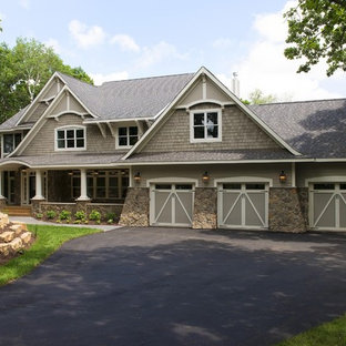 Inspiration for a large timeless gray two-story wood gable roof remodel in Minneapolis