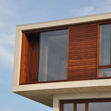 Beach Style Exterior by aamodt / plumb architects