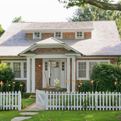 Elegant wood exterior home photo in New York with a clipped gable roof