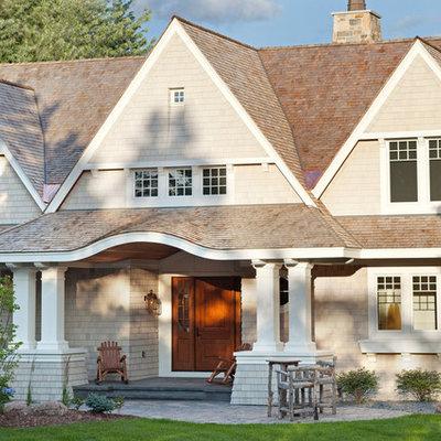 Elegant beige two-story gable roof photo in Minneapolis