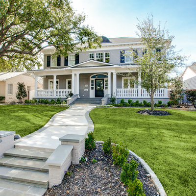 Example of a large classic gray two-story brick house exterior design in Dallas with a hip roof and a shingle roof
