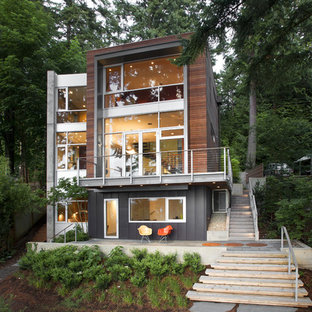 Example of a mid-sized trendy brown three-story wood exterior home design in Seattle