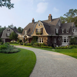 Huge elegant brown three-story mixed siding house exterior photo in Boston with a gambrel roof and a shingle roof
