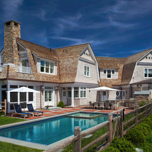Beach Style Beige Two Story Wood Exterior Home Idea In New York With A  Gambrel