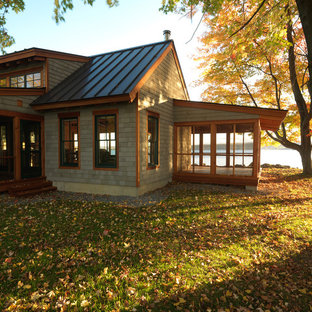 Rustic one-story wood exterior home idea in Burlington