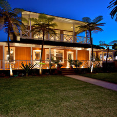 Tropical Exterior by Flagg Coastal Homes