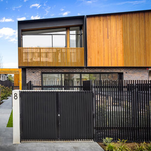 Design ideas for a contemporary two-storey multi-coloured house exterior in Other with mixed siding and a shed roof.