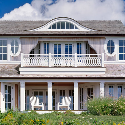 Example of a huge beach style gray two-story wood house exterior design in Boston with a shingle roof