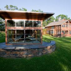Rustic Exterior by Austin Design Inc