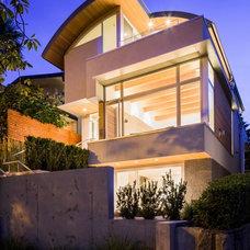 Contemporary Exterior by Frits de Vries Architect Ltd.
