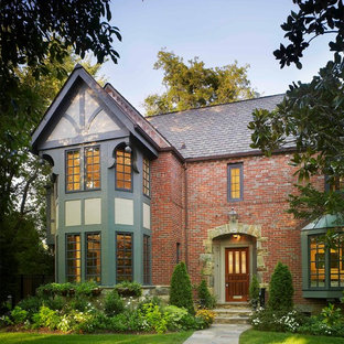 This is an example of a mid-sized traditional three-storey exterior in DC Metro with mixed siding and a gable roof.