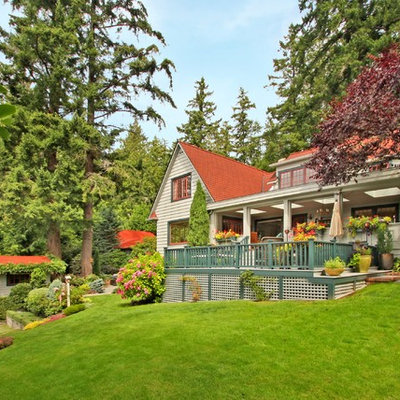 Inspiration for a large cottage beige two-story wood exterior home remodel in Seattle