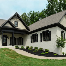 Traditional Exterior by Luxe Homes and Design