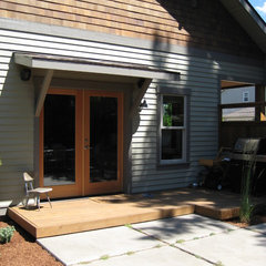 traditional exterior by Conscious Construction Inc.
