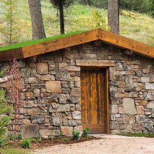 Mountain style stone exterior home photo in Denver