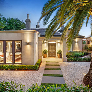 Inspiration for a large transitional beige house exterior in Melbourne with a hip roof and a tile roof.