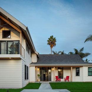 Contemporary white two-story exterior home idea in San Diego with a shingle roof