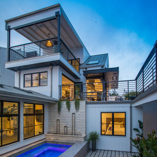 Beach style white three-story house exterior idea in Los Angeles