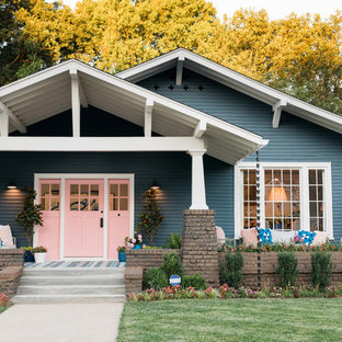 Inspiration for a craftsman blue one-story brick house exterior remodel in Other