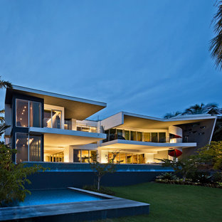 Inspiration for a large modern gray two-story stucco exterior home remodel in Miami