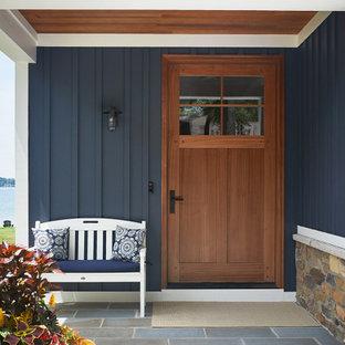 На фото: маленький, двухэтажный, синий частный загородный дом в морском стиле с комбинированной облицовкой, двускатной крышей и крышей из смешанных материалов