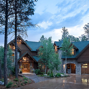 Inspiration for a large rustic three-story mixed siding exterior home remodel in Albuquerque