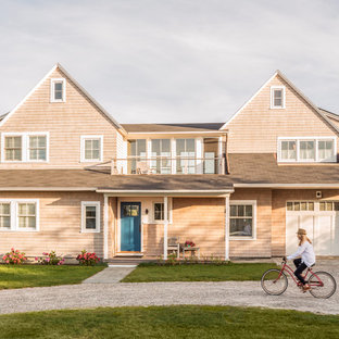 Mid-sized coastal beige two-story wood exterior home photo in Portland Maine with a shingle roof