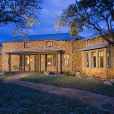 Rustic Exterior by chas architects