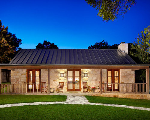 Texas hill country limestone houzz for Texas ranch house plans with porches