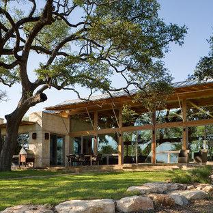 Rustic stone exterior home idea in Austin