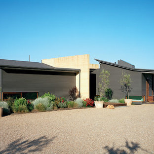 Inspiration for a large contemporary gray split-level metal exterior home remodel in Melbourne