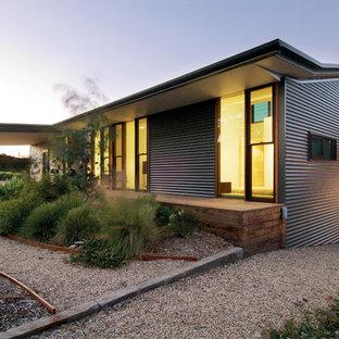 Inspiration for a large industrial gray split-level metal exterior home remodel in Melbourne