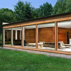 Midcentury Exterior by Jeff Jordan Architects LLC