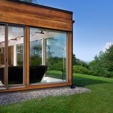 Midcentury Exterior by Jeff Jordan Architects LLC
