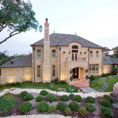 Traditional two-story stone exterior home idea in Dallas