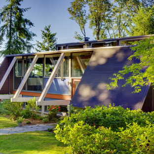Eclectic one-story wood flat roof idea in Seattle