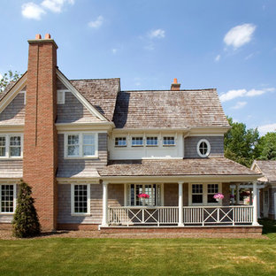 Traditional brown two-story wood exterior home idea in Chicago with a shingle roof