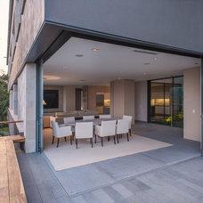 Contemporary Exterior by RHYZOMA - Arquitectura / Diseño