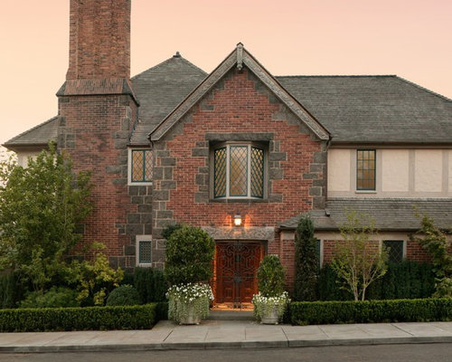 Example Of A Large Classic Brown Two Story Brick Exterior Home Design In Seattle