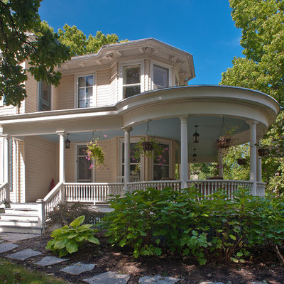 Inspiration for a large victorian pink two-story wood exterior home remodel in Chicago
