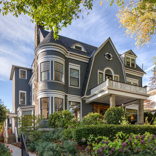 Ornate gray two-story house exterior photo in Portland with a gambrel roof and a shingle roof