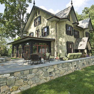 Huge elegant green three-story stone house exterior photo in Philadelphia with a tile roof