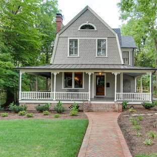 Small country gray two-story wood house exterior idea in Raleigh with a gambrel roof and a shingle roof