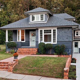 Mid-sized traditional gray two-story mixed siding house exterior idea in Charlotte with a hip roof and a shingle roof
