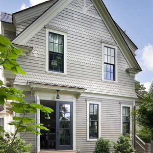 Ornate wood exterior home photo in Boston
