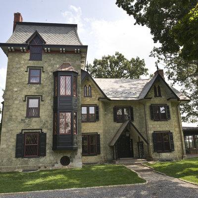 Huge victorian green three-story stone exterior home idea in Philadelphia