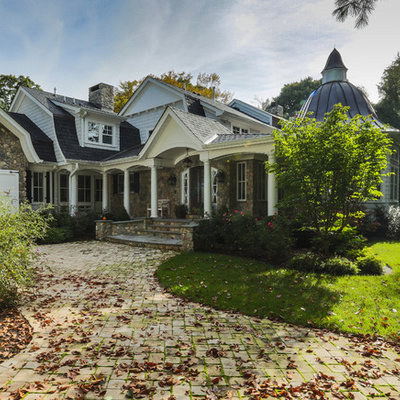 Example of a classic stone exterior home design in New York