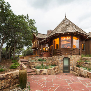 Example of a mountain style brown two-story wood exterior home design in Denver with a shingle roof
