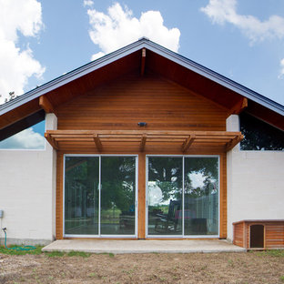Inspiration for a modern wood exterior home remodel in Austin